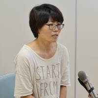 Mio Fujimoto, the mother of a toddler found safe in western Japan, speaks at a hospital where her son received care in Yamaguchi Prefecture on Wednesday. | KYODO