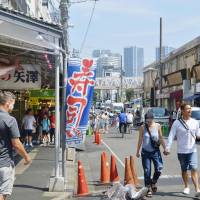 The Tsukiji outer market, which is currently adjacent to the Tsukiji fish market in Tokyo, is soliciting a new name before the fish market relocates to the Toyosu area. | KYODO