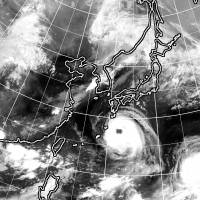 Two typhoons are seen approaching Japan in this satellite image captured on Aug. 21. | KYODO