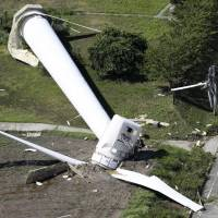 A wind turbine in a park on Awaji Island in Hyogo Prefecture was found lying on the ground Friday morning after Typhoon Cimaron passed over western Japan. | KYODO