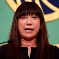 Myu, the wife of Japanese freelance journalist Jumpei Yasuda who has been held by militants in Syria for three years, speaks at a news conference at the Japan National Press Club in Tokyo on Tuesday after a video recently surfaced appearing to show her husband pleading for help. | REUTERS