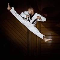 High flyer:  Chuck Johnson's first stop in Asia was South Korea, where he aimed to raise his taekwondo skills to the Olympic level. | COURTESY OF CHUCK JOHNSON