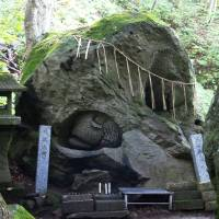 Ishigami Shrine, Aomori Prefecture, is a well-known 'power spot.' Enshrined is a large rock called the 'Ishigami-sama,' revered for its reputed healing powers emanating from crevices that look like human eyes. | COURTESY OF YUKI YOSHIDA