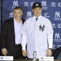 Pitcher Masahiro Tanaka signed a seven-year contract with the New York Yankees worth $155 million in January 2014. | KYODO