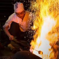 Fire work with me: A man works on a blade in the Osaka prefectural city of Sakai. | COURTESY OF THE CITY OF SAKAI