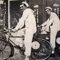 U.S. Navy personnel ride an early version of Honda's 'Cub' around 1952. | MARK SCHREIBER