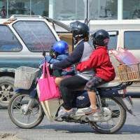 Honda's reliable Super Cub is widely sold in Southeast Asian markets.   GETTY IMAGES