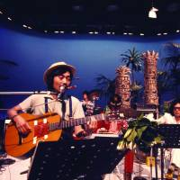 On screen: Haruomi Hosono takes part in a taping for the TV show 'Young Impulse' in July 1975. | COURTESY OF THE MASASHI KUWAMOTO ARCHIVES/ VIA LIGHT IN THE ATTIC
