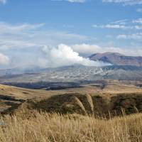 Fit for a villain: The smoking crater and volcanic landscape of Mount Aso, Kumamoto Prefecture, which features in the James Bond novel 'You Only Live Twice.' | OSCAR BOYD