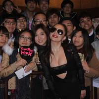 Up close and personal: Singer Ayumi Hamasaki (center) poses with fans on a street in Hong Kong in 2016. | GCMT — IMAGINECHINA