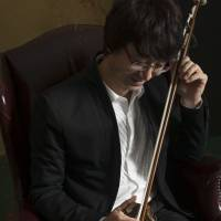 A man and his music: Jia Pengfang fell in love with his instrument, the erhu, when he was just a child. His talent for playing it took him to the big city and, eventually, around the world. | TATSUYA NAOE