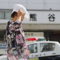 In the summertime: The government has said it would consider introducing daylight savings time ahead of the Olympics in order to mitigate the effects of hot weather. | KYODO