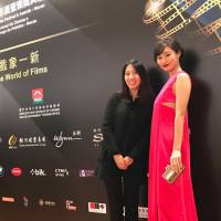 Working with winners: Yukie Kito (left) with actress Shioli Kutsuna, who was presented with a Rising Stars of Asia award at the International Film Festival and Awards Macao, Macau.