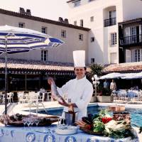 Chef Joel Robuchon poses holding a fish in Port Grimaud, southeastern France, May 1984. | AFP-JIJI