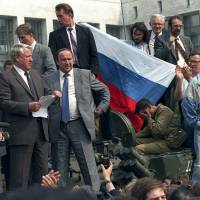 Russian President Boris Yeltsin (foreground left) addresses the crowd from atop a tank in Moscow during an attempted coup on Aug. 19, 1991 | AP