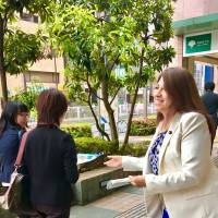 On the stump: Bolivian-born city councilor Noemi Inoue hands out campaign pamphlets in Tokyo's Sumida Ward. Her successful re-election campaign in 2015 was featured on NHK World TV. | COURTESY OF NOEMI INOUE