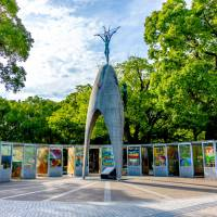 Left: The Children's Peace Monument, topped by the figure of Sadako Sasaki, is surrounded by paper cranes donated to Hiroshima's Peace Memorial Park from around the world. The nine booths surrounding the monument were installed by the city in 2002 to protect the cranes. | PETER CHORDAS