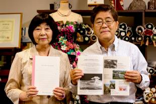 For a friend: Tomiko Kawano and Seiji Okamura of Peace Minds Hiroshima show the notebooks their group began making this year from recycled paper cranes.