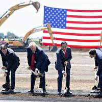 U.S. President Donald Trump and Terry Gou, chairman of Foxconn Technology Group (second from right), break ground for a Foxconn facility in Mount Pleasant, Wisconsin, on June 28. Trump was full of praise for the Taiwanese company that has promised to bring jobs to a state critical to his re-election. | BLOOMBERG