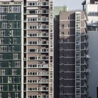 Hundreds of millions of workers have migrated from rural China to urban-area residential towers, like these in Beijing. | BLOOMBERG