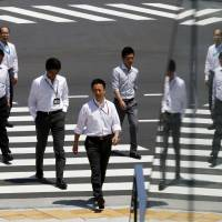 In exchange for job security, Japanese firms have demanded higher loyalty from employees than required elsewhere. Talented salarymen are also underpaid compared with their peers at non-Japanese companies. | REUTERS