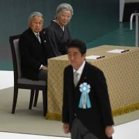 Emperor Akihito and Empress Michiko watch as Prime Minister Shinzo Abe walks toward the altar during the annual official memorial service for war victims on Aug. 15 in Tokyo. The Emperor is due to abdicate next April 30, which will bring an end to the Heisei Era. | AFP-JIJI
