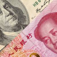 Is the Chinese currency rising on the world stage? Don't bet on it, many economists warn.   GETTY IMAGES
