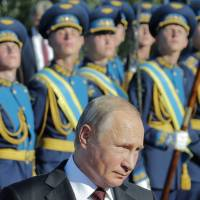 Russian President Vladimir Putin attends a ceremony to commemorate the 75th anniversary of the Battle of Kursk in World War II on Thursday. | REUTERS