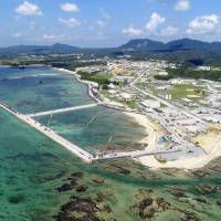 Seawall construction work is underway July 27 for relocating the functions of the U.S. Futenma military base from Ginowan, Okinawa Prefecture, to the Henoko coastal area of Nago, also in Okinawa. | KYODO