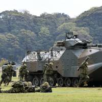 The Ground Self-Defense Force's new Amphibious Rapid Deployment Brigade carries out a demonstration exercise April 7 in Sasebo, Nagasaki Prefecture. | KYODO
