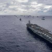 Naval ships from various nations participating in RIMPAC 2018 assemble for a photo exercise off the coast of Hawaii on July 26. | AFP-JIJI