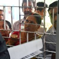 A woman whose name was left off the National Register of Citizens draft tries to file an appeal in Guwahati in the northeastern Indian state of Assam on Aug. 11. Around 4 million people in Assam were not included in the draft list, sparking  fears of deportation for large numbers of Muslims.   AFP-JIJI