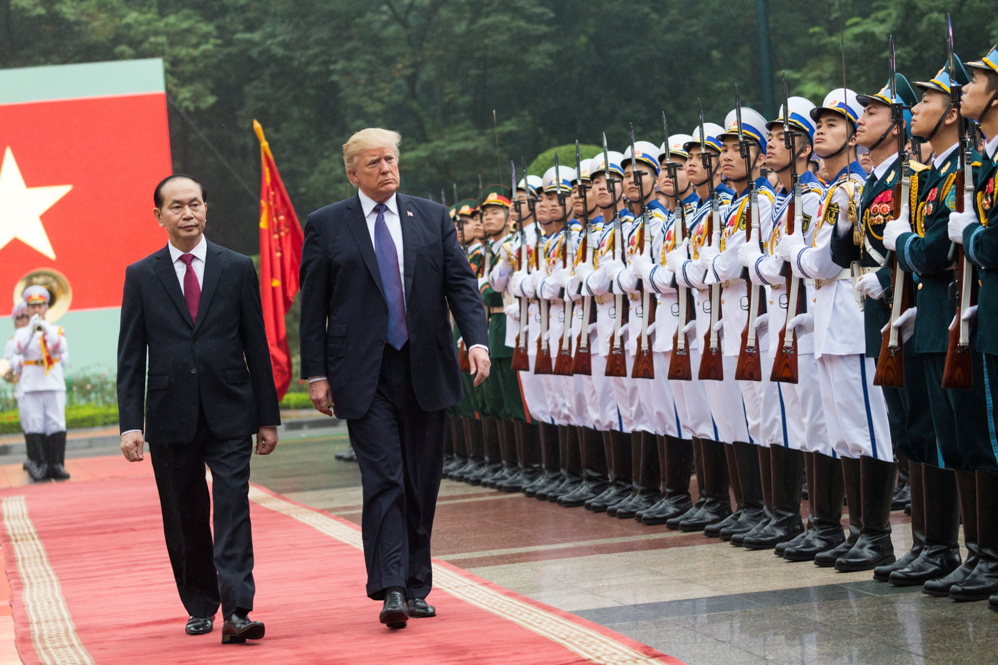 Vietnamese State President Tran Dai Quang and U.S. President Donald Trump review an honor guard in Hanoi on Nov. 12. | THE WHITE HOUSE