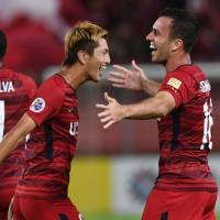 Kashima Antlers midfielder Sergio Antonio Junior (right) with teammate Yuma Suzuki after scoring a goal during the Asian Champions League quarterfinal first leg against China's Tianjin Quanjian at Kashima Stadium on Tuesday. | AFP-JIJI