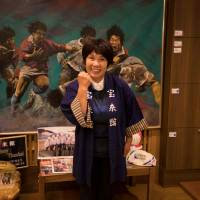 Akiko Iwasaki, the landlady of the Horaikan inn, was almost swept out to the sea by the tsunami but survived by clinging onto the inn's minibus. | AFP-JIJI
