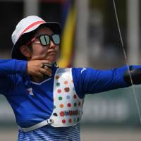 Tomomi Sugimoto fires an arrow during the mixed recurve archery final against North Korea at the Asian Games in Jakarta on Monday. | AFP-JIJI