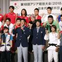 Members of Japan's team for the 2018 Asian Games in Jakarta pose for a picture at a ceremony in Tokyo on Monday.