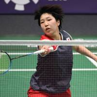 Akane Yamaguchi plays a shot during her Asian Games women's singles semifinal against India's V. Sindhu Pusarla in Jakarta on Monday. | AFP-JIJI