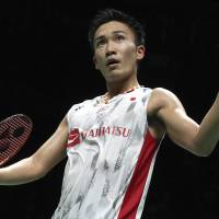 Kento Momota reacts after beating China's Shi Yuqi in the men's singles final at the world badminton championships on Sunday in Nanjing, China. | AP