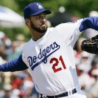 Former Dodgers starting pitcher Esteban Loaiza, seen in a spring training game in March 2008, faces a minimum of 10 years in prison after pleading guilty to federal drug charges on Friday. | AP