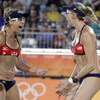 U.S. beach volleyball icon Kerri Walsh Jennings (right), seen celebrating a point with partner April Ross during a 2016 Rio Olympics match, will end her legendary career after the 2020 Tokyo Games. | AP