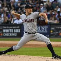Indians starter Trevor Bauer will be out four to six weeks because of a stress fracture in his right leg.   AP