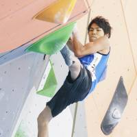 Tomoa Narasaki competes in bouldering qualification in the sport climbing men's combined event at the Asian Games on Friday in Palembang, Indonesia. | KYODO
