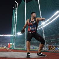 Masateru Yugami competes in the men's discus final on Wednesday at the Asian Games in Jakarta.
