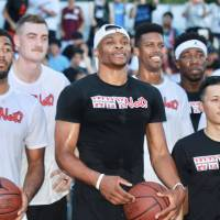 Russell Westbrook (center) competes in an exhibition game on Tuesday as part of his Nike promotional tour. | KAZ NAGATSUKA