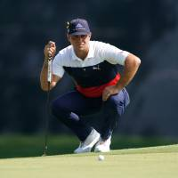 Gary Woodland lines up a putt on the 10th hole during the first round of the PGA Championship on Thursday. | USA TODAY / VIA REUTERS