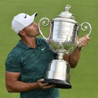 Brooks Koepka kisses the trophy after winning the PGA Championship on Sunday in St. Louis. | USA TODAY / VIA REUTERS