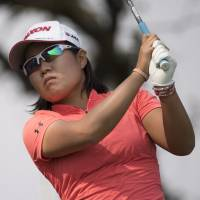 Nasa Hataoka tees off on the 12th hole during the second round of the CP Women's Open on Friday. Hataoka carded a 70 and is three shots off the pace. | AP
