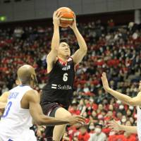Japan guard Makoto Hiejima, seen attacking the basket against Taiwan in a FIBA World Cup Asian qualifier in February in Yokohama, is moving to Australia to play for the Brisbane Bullets. | KAZ NAGATSUKA