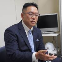 Yasutoshi Okuno, the father of the Kwansei Gakuin quarterback who was tackled illegally during a game against Nihon University in on May 6, speaks to The Japan Times on Monday. | HIROSHI IKEZAWA
